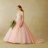 オレンジ☓ピンク×ラベンダーの三色で作ったニュアンスカラーのドレスです。歩いて揺れ動く度に重ねたチュールスカートが様々な色の表情を見せてくれます。