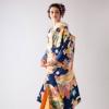 西陣織で格調高い吉祥文様を施した贅沢な色打掛。鮮やかな青が格調高い印象を醸す逸品です。