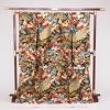 吉祥文様の松や菊、四季の草花や孔雀を色鮮やかに織り成した、豪華な打掛です。