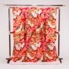 伝統的な日本の文様、鶴や桜、松を赤地に見事に織り出した打掛は、華やかさの中に格調の高さを醸し出しています。
